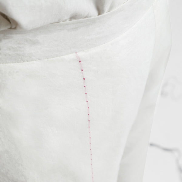 Front Detail of a Model wearing Hand-Embroidered White Straight Pant