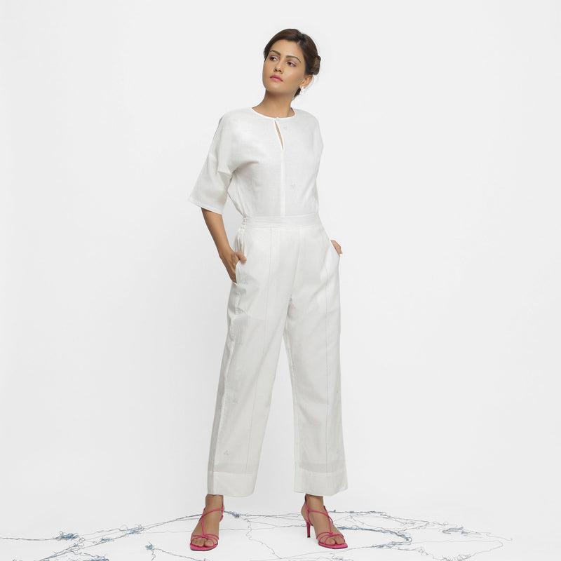 Front View of a Model wearing Off-White Banded Hem Straight Pant