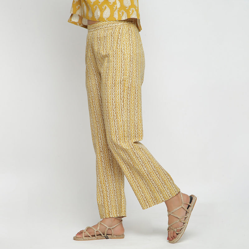 Left View of a Model wearing Mustard Bagru Block Print Straight Pant