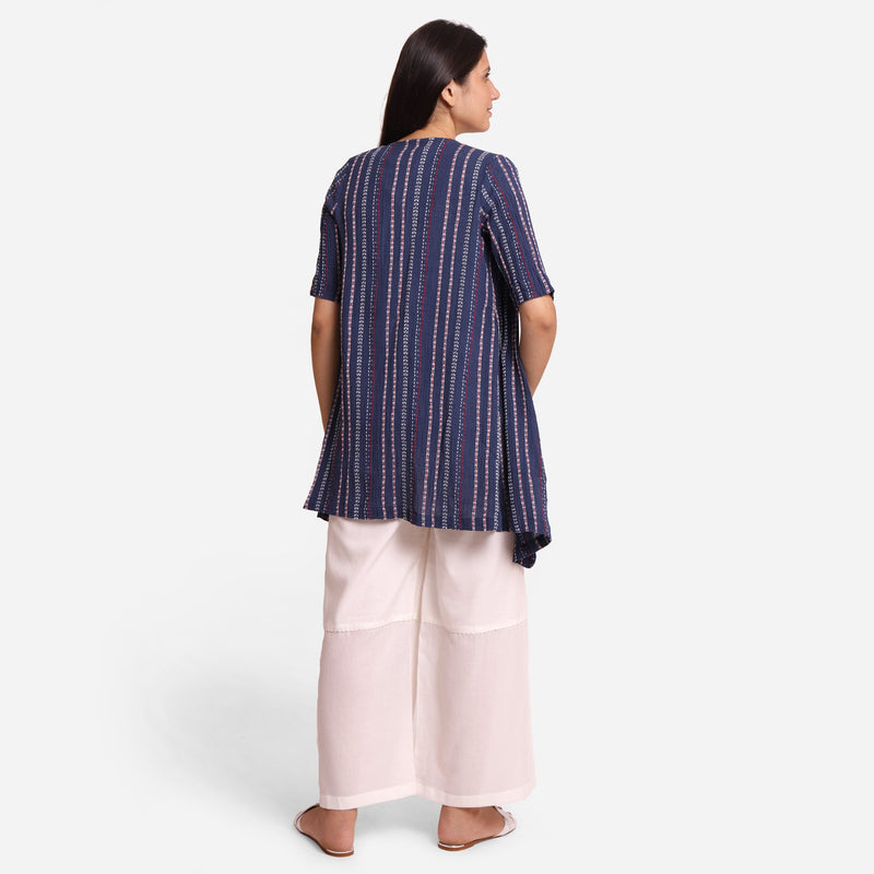 Back View of a Model wearing Navy Blue Crinkled Cotton Striped Overlay