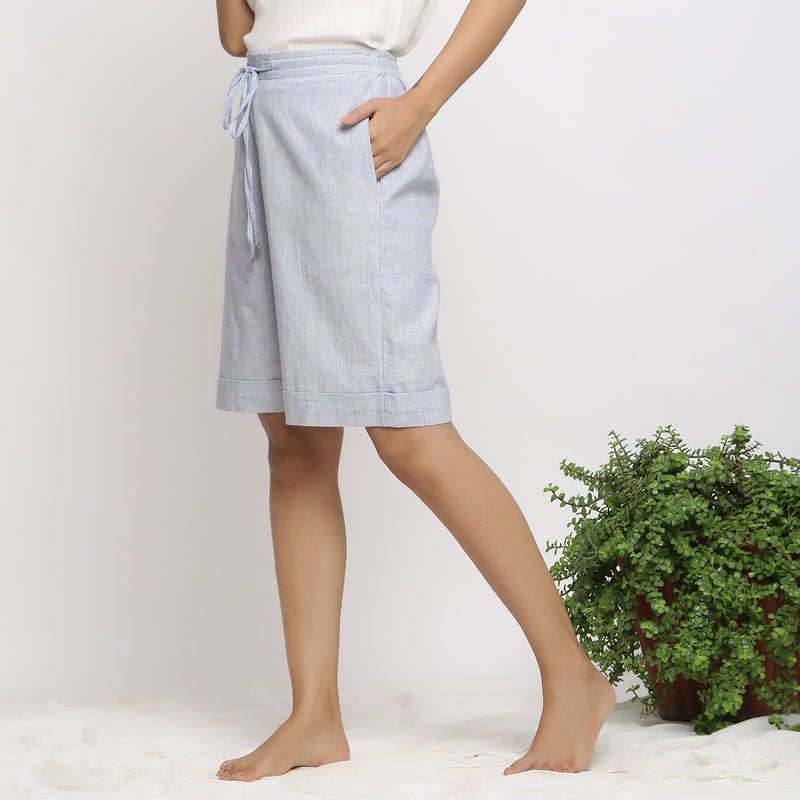 Left View of a Model wearing Sky Blue Handspun Cozy Bermuda Shorts