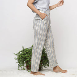 Right View of a Model wearing Handspun Cotton Striped Tapered Pant