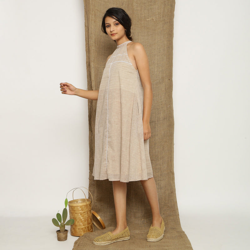 Left View of a Model wearing Handspun Cotton Lace Paneled Dress