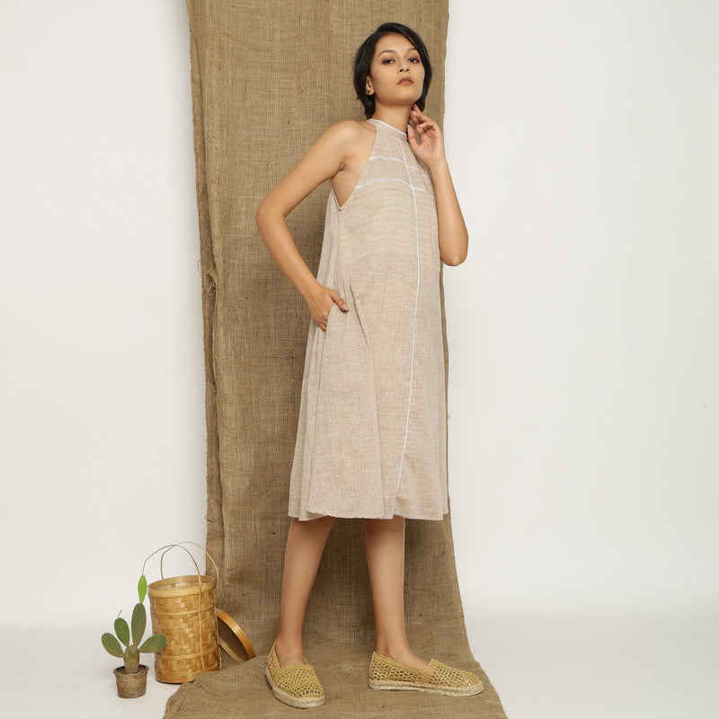 Right View of a Model wearing Handspun Cotton Lace Paneled Dress
