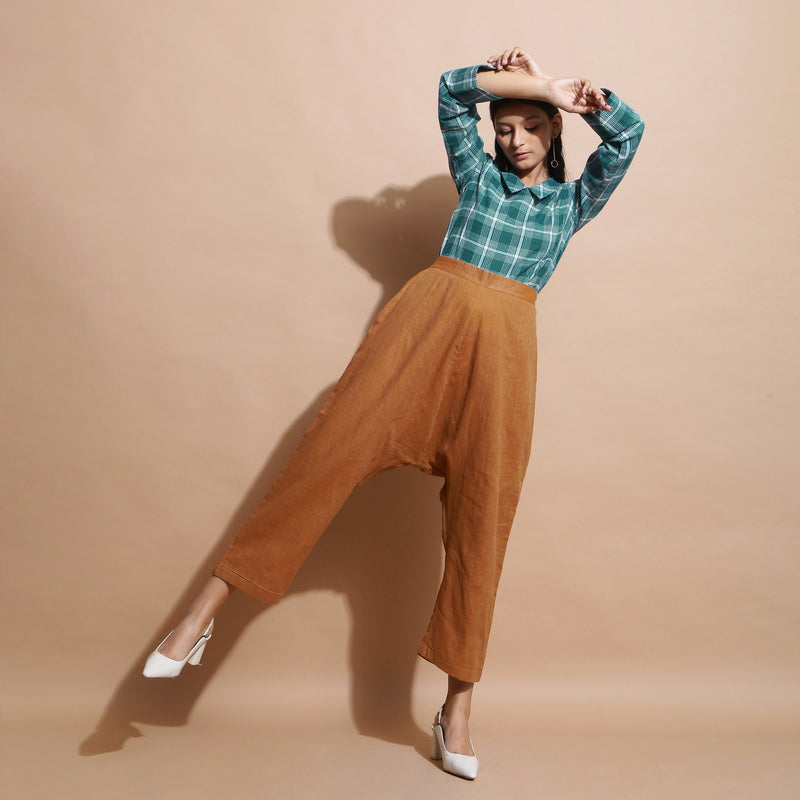 Front View of a Model wearing Handspun Cotton Muslin Mid Rise Pant