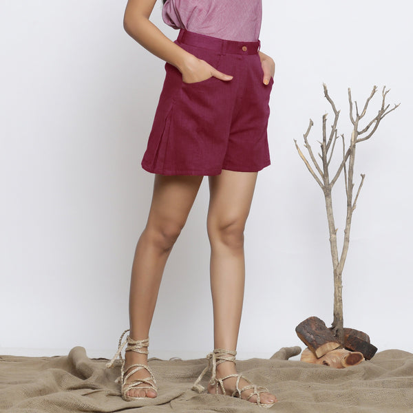 Right View of a Model wearing Handspun Maroon Flared Shorts