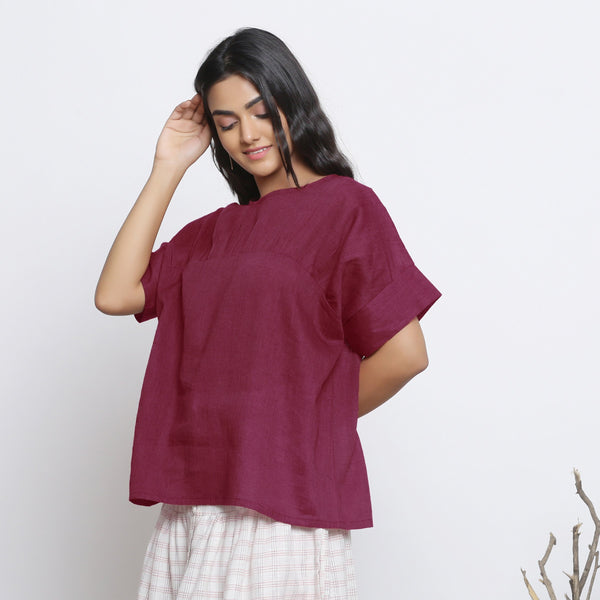 Front View of a Model wearing Handspun Maroon Yoked Top