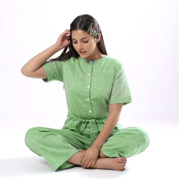 Front View of a Model wearing Handspun Mint Green Paneled Button-Down Jumpsuit