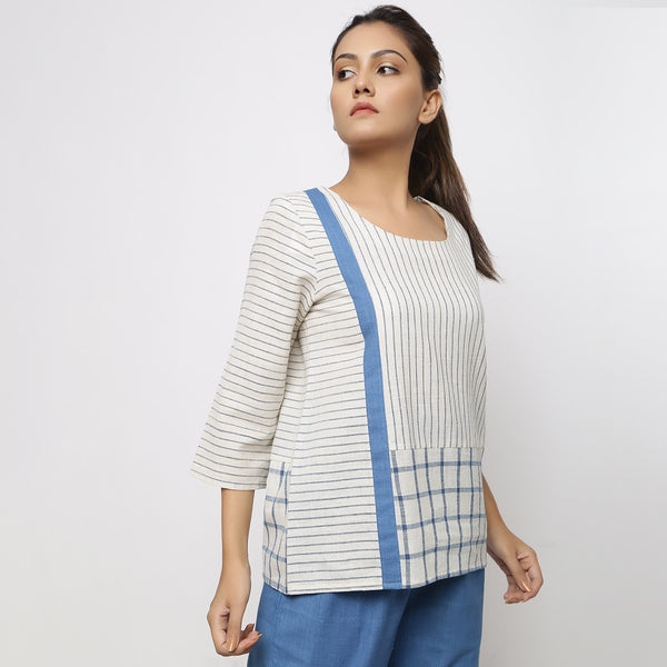 Right View of a Model wearing Handspun Vegetable Dyed Straight-Fit Top