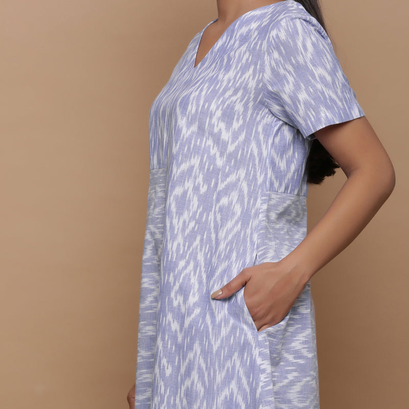 Left View of a Model wearing Handwoven Cotton Geometric Print Dress