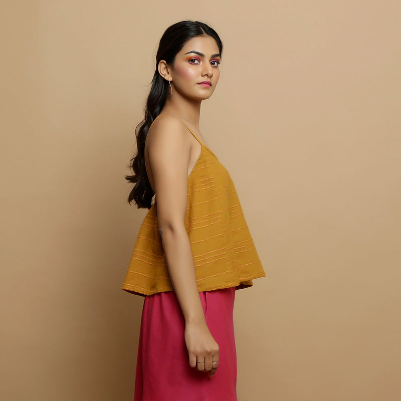 Right View of a Model wearing Handwoven Cotton Flared Godet Top