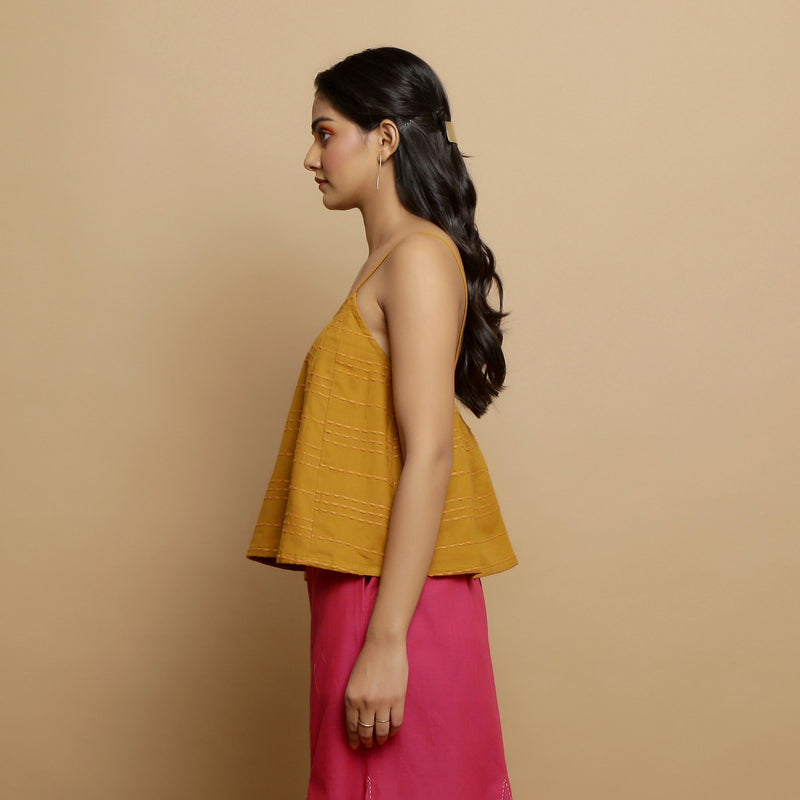 Left View of a Model wearing Handwoven Cotton Flared Godet Top