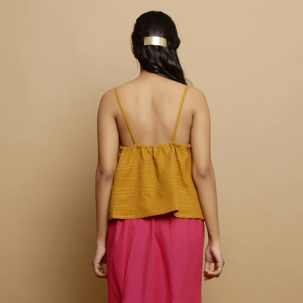 Back View of a Model wearing Handwoven Cotton Godet Camisole Top