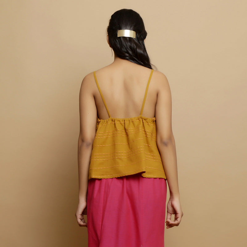 Back View of a Model wearing Handwoven Cotton Flared Godet Top