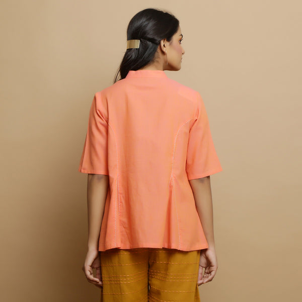 Back View of a Model wearing Handwoven Cotton Godet Button-Down Top