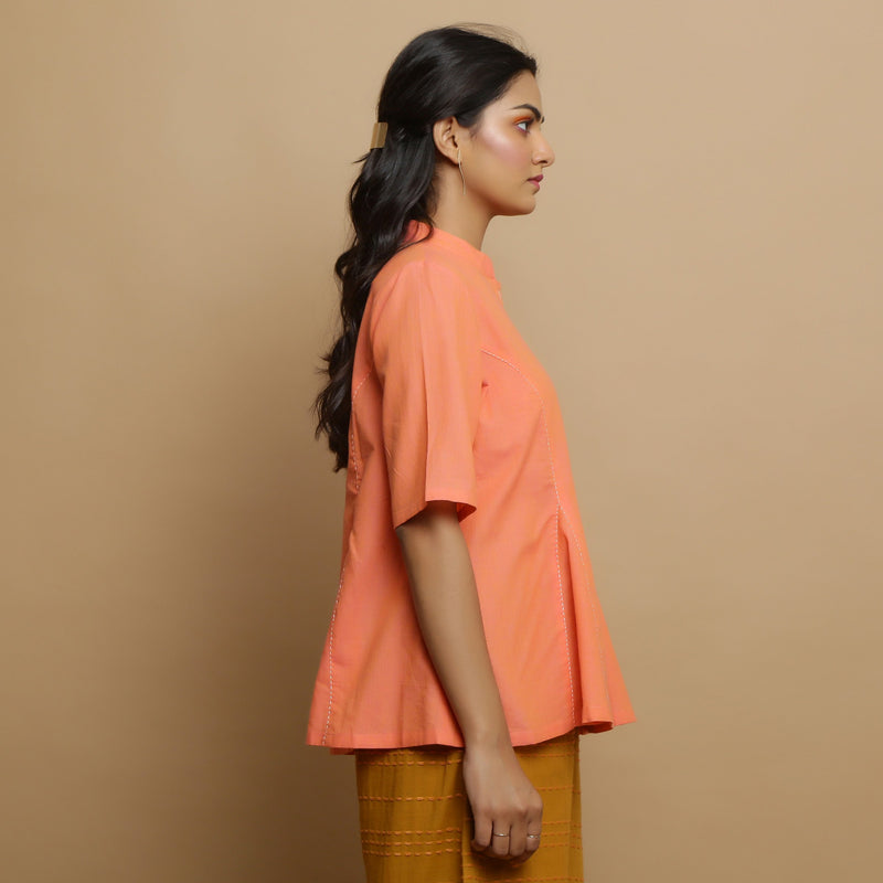 Right View of a Model wearing Handwoven Cotton Godet Button-Down Top