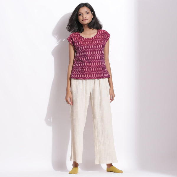 Front View of a Model wearing Handwoven Ikat Berry Wine Straight Top