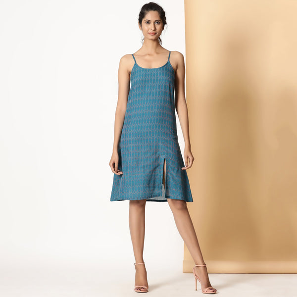 Front View of a Model wearing Handwoven Ikat Teal Strappy Slit Dress