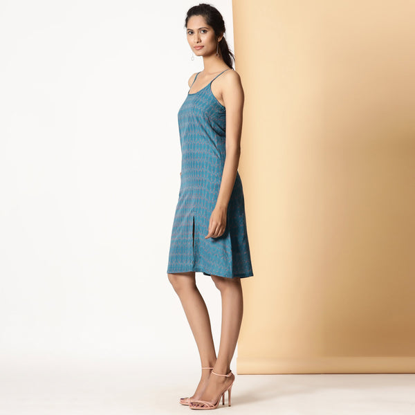 Left View of a Model wearing Handwoven Ikat Teal Strappy Slit Dress