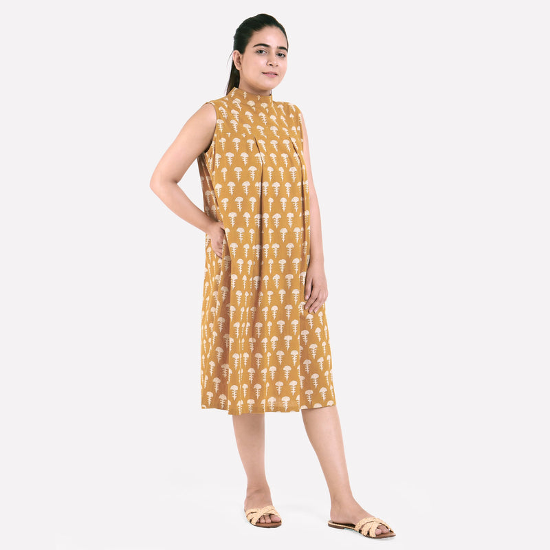 Right View of a Model wearing Bagru Block Print Mustard Pleated Dress