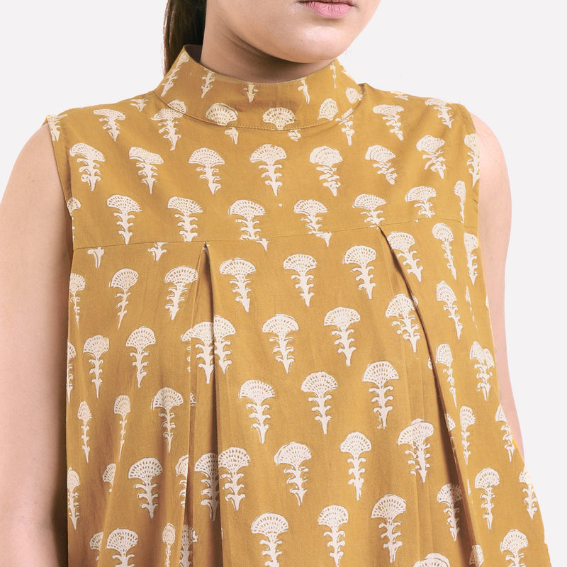 Front Detail of a Model wearing Bagru Block Print Mustard Pleated Dress