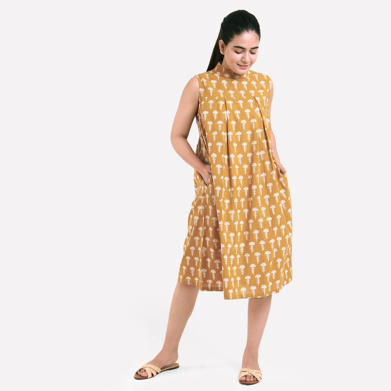 Front View of a Model wearing Bagru Block Print Mustard Pleated Dress