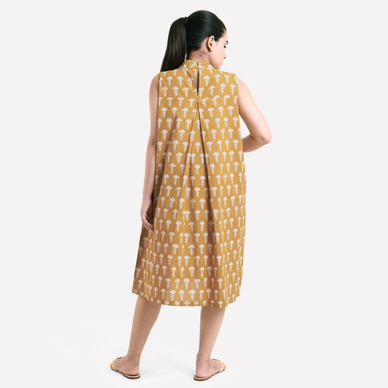Back View of a Model wearing Bagru Block Print Mustard Pleated Dress