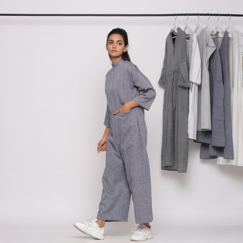 Left View of a Model wearing Handspun Charcoal Grey Straight Jumpsuit