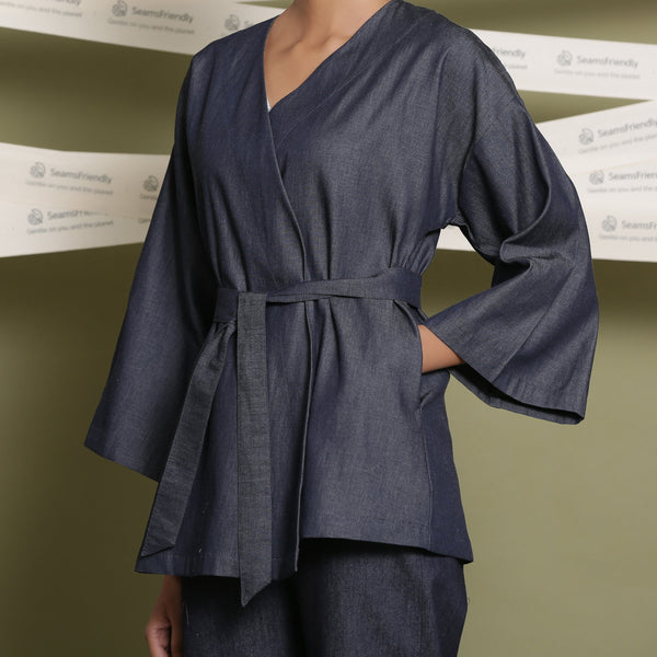 Front Detail of a Model wearing Indigo Cotton Denim Drop Shoulder Sleeve Overlay