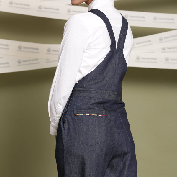 Back Detail of a Model wearing Indigo Cotton Denim Slim Fit Dungaree