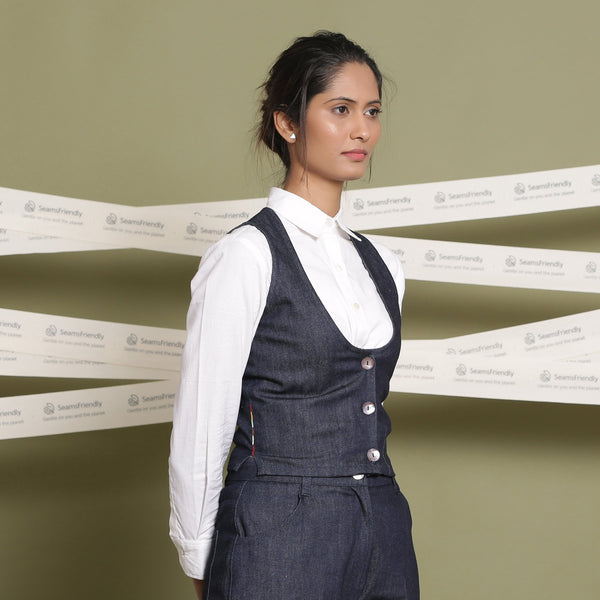 Right View of a Model wearing Indigo Cotton Denim Slim Fit Vest