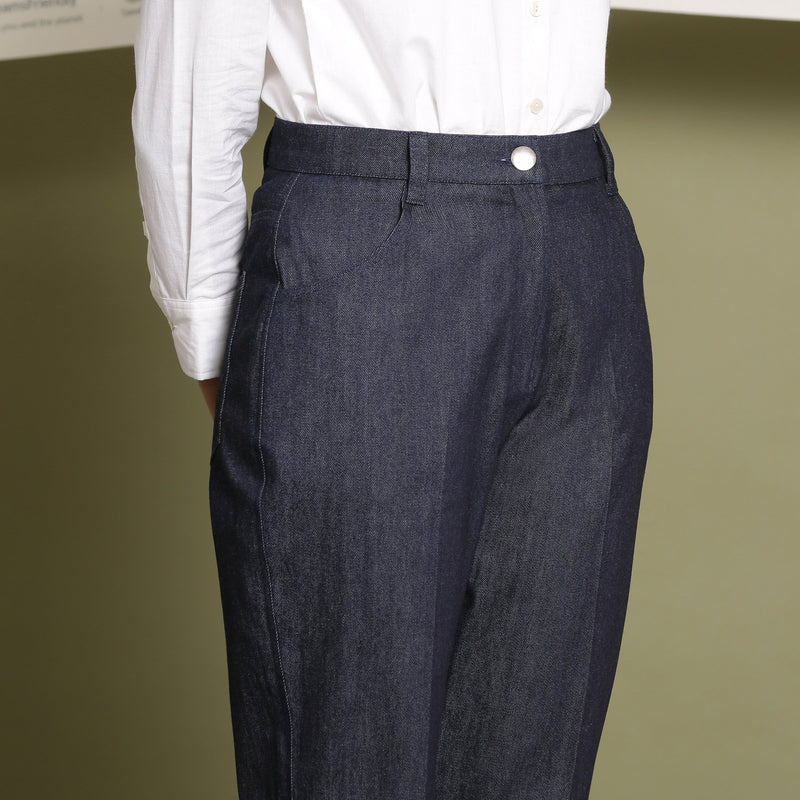 Front Detail of a Model wearing Indigo Cotton Denim Tapered Pant