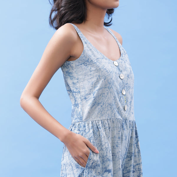 Front Detail of a Model wearing Indigo Dabu Printed Button-Down Jumpsuit