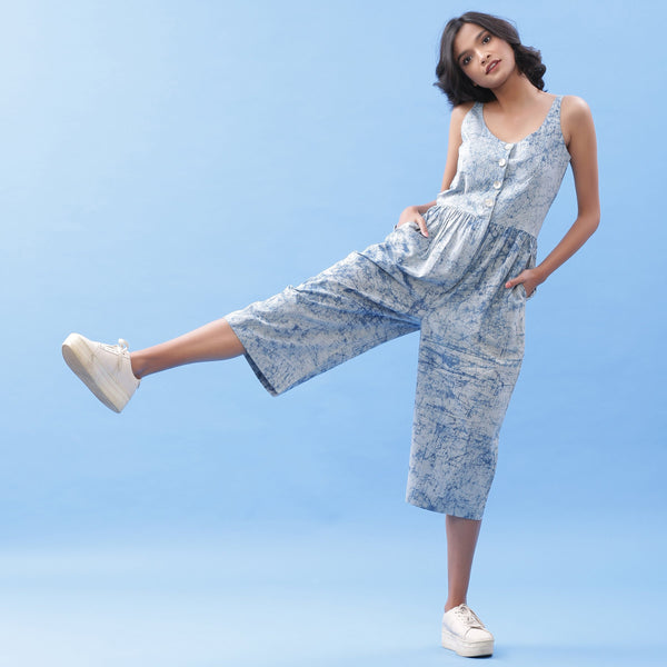 Front View of a Model wearing Indigo Dabu Printed Button-Down Jumpsuit