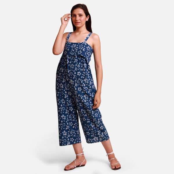 Front View of a Model wearing Indigo Floral Flared Jumpsuit