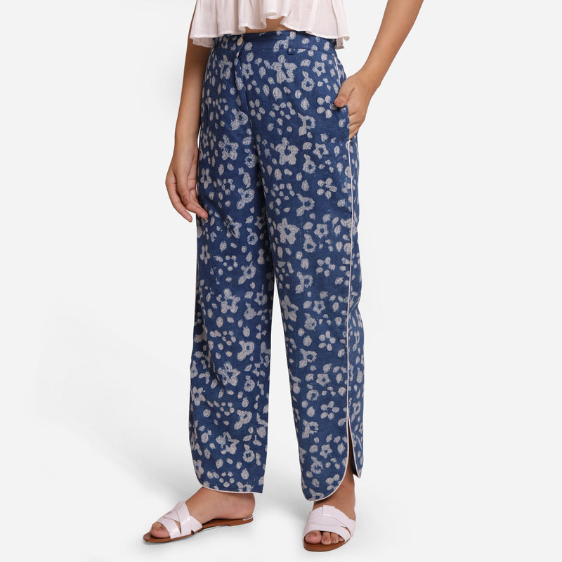 Left View of a Model wearing Indigo Floral High-Rise Pants