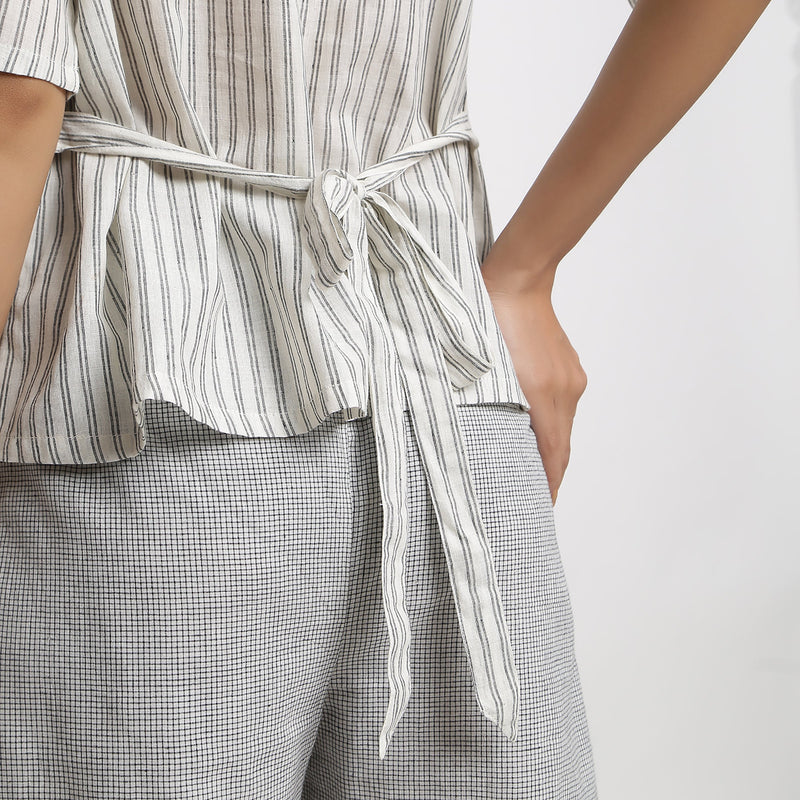 Back Detail of a Model wearing Ivory and Charcoal Striped A-line Top