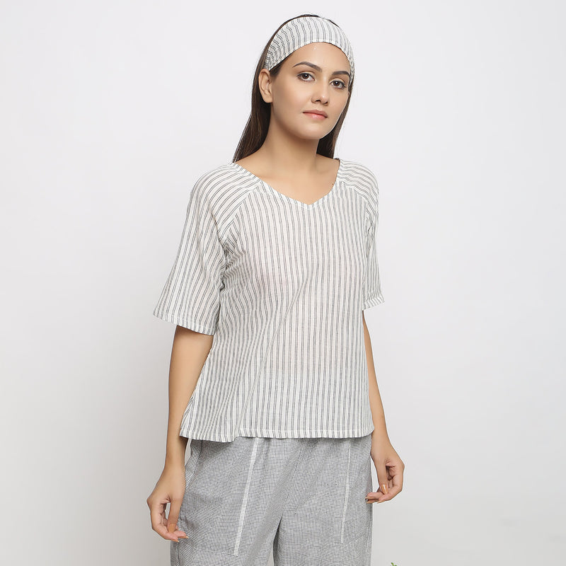 Front View of a Model wearing Ivory and Charcoal Striped A-line Top