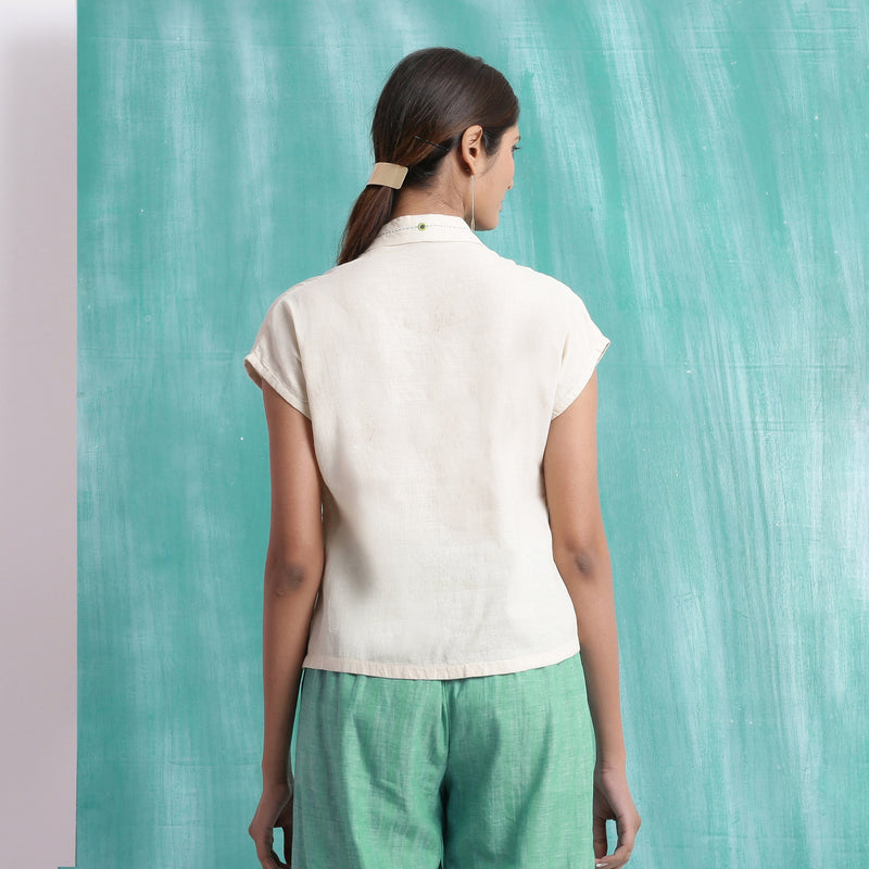 Back View of a Model wearing Ivory Handspun Relaxed Mirror Work Shirt