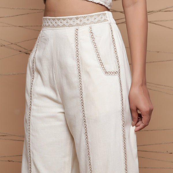 Left View of a Model wearing Jute Laced Cotton Ecru Straight Pant