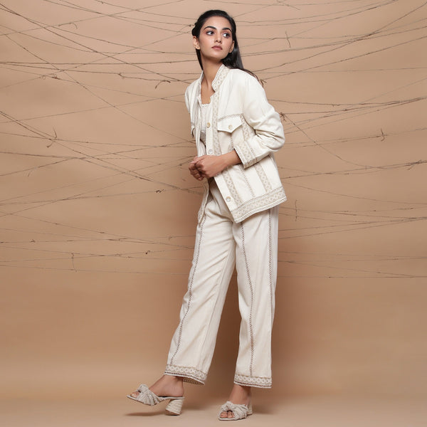 Left View of a Model wearing Jute Laced Straight Pant and Cargo Jacket Set