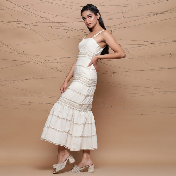 Left View of a Model wearing Jute Laced Undyed Ivory Sheath Dress