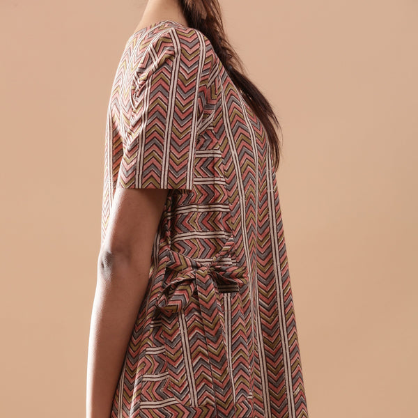 Right Detail of a Model wearing Kalamkari Chevron Striped Paneled Dress
