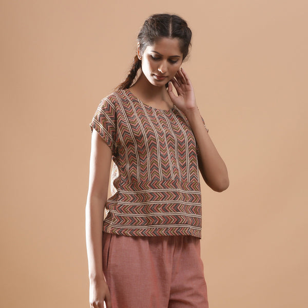 Right View of a Model wearing Kalamkari Chevron Striped Yoked Top