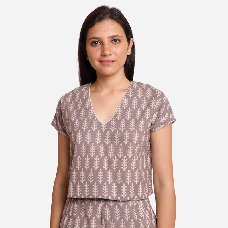 Front View of a Model wearing Grey Dabu Block Print V-Neck Crop Top