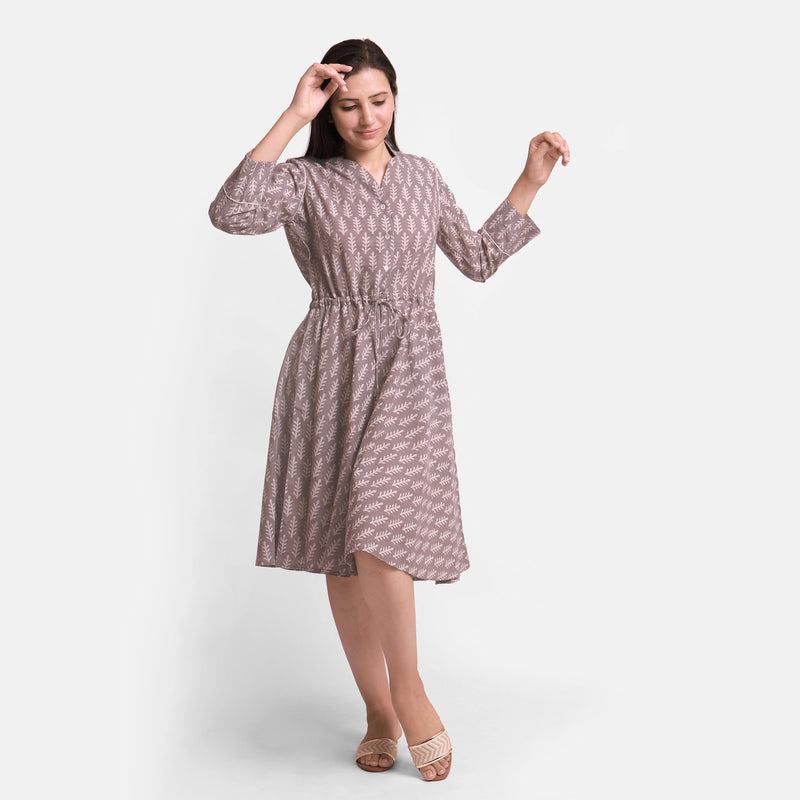 Front View of a Model wearing Kashish Botanical Pattern Button-Down Dress