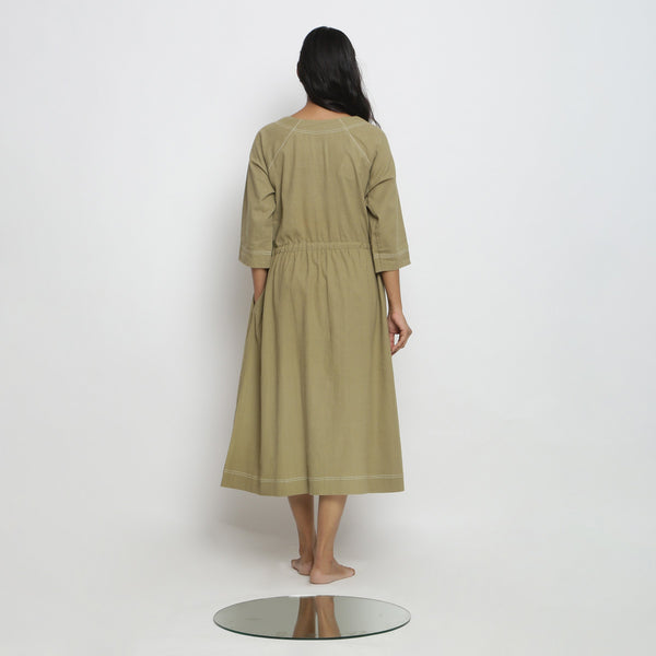 Back View of a Model wearing Khakhi Green Vegetable Dyed Button-Down Dress