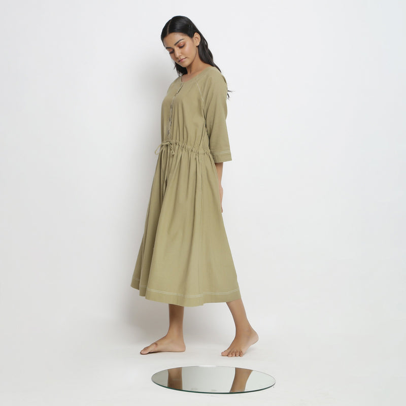 Left View of a Model wearing Khakhi Green Vegetable Dyed Button-Down Dress