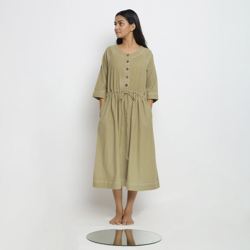 Front View of a Model wearing Khakhi Green Vegetable Dyed Button-Down Dress