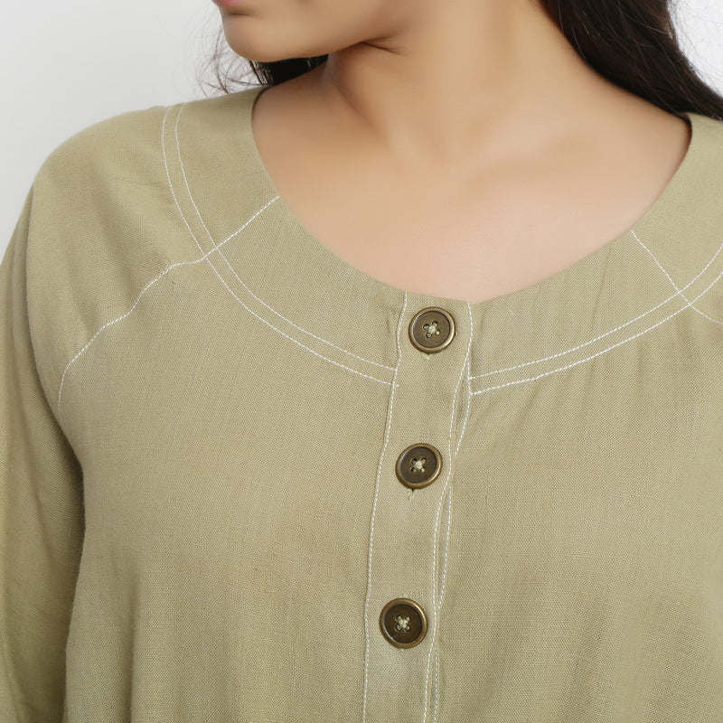Front Detail of a Model wearing Khakhi Green Vegetable Dyed Button-Down Dress